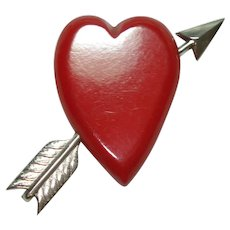 Red Bakelite Carved Heart with Arrow Pin