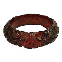 Heavily Carved Transparent Ruby Red Bakelite Bangle Bracelet