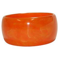 Wide Translucent Marbled Orange Bakelite Bangle Bracelet