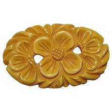 Large Oval Pierced Carved Butterscotch Bakelite Flower Pin