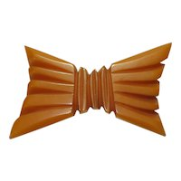 Carved Butterscotch Bakelite Bow Pin