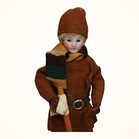 Unusual glass eyed doll original ski outfit with accessories