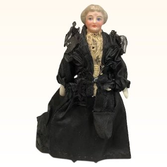 Dollhouse Grandma with vintage clothing