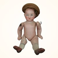 All bisque doll with human hair