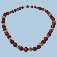 Natural red Coral and Gold Necklace, 20th century.