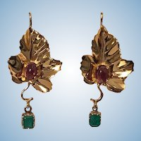Pair of 18K Emerald and Garnet Maple Leaf drop Earrings, 20th century.