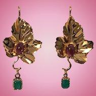 Pair of 18K Emerald and Garnet Maple Leaf drop Earrings, 20th century.
