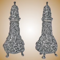 Pair of Stieff Sterling Silver Rose Repousee Casters, 1915