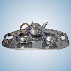 Archibald Knox Liberty Tudric pewter Tea set and Tray, C.1905.