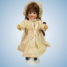 Adorable small German bisque head 11 inches .