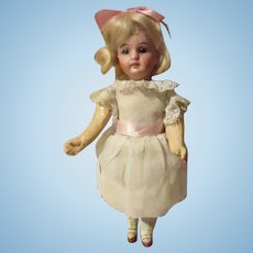 Cute small bisque head by Gerbruder Kuhnlenz  , Germany 7 inch