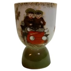Porcelain Eggcup Children in 1915 Car
