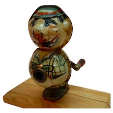 Figural Pencil Sharpener Man in Lederhosen Litho Tin