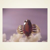 Nice 10k Garnet Ring/size 6 3/4. It is a Marquis shaped 1.5 carat stone.