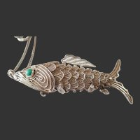 Vintage Filigreee Fish that opens  his mouth. It is marked silver on inside Flap of his mouth. .He has moveable parts.
