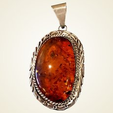 Vintage. Sterling and Amber pendant possibly Navajo BB