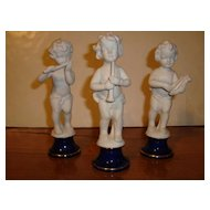 Set of 3 French cherubs with musical instruments made of bisque porcelain