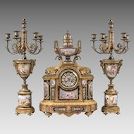 19th C. Bronze Mounted Sevres Jeweled Cobalt Ground 3 Piece Garniture, Clock With Matching Candelabras