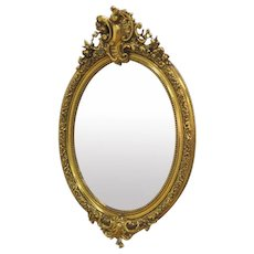 French Bell Epoque Giltwood And Composition Oval Mirror