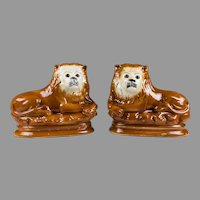 Matched Pair of Staffordshire Recumbent Pottery Lions With Glass Eyes