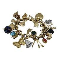 "14K Charm Bracelet Loaded w/ 22 Gold Charms 66.2 Grams 7 1/2"" Long"
