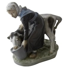 Royal Copenhagen Milkmaid Feeding Cow Figure #779