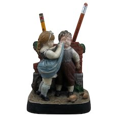 Early 1900s Figural Ceramic Pencil Holder Girl Wiping Boy's Face