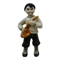 1948 Ceramic Arts Sax Boy Figure Betty Harrington
