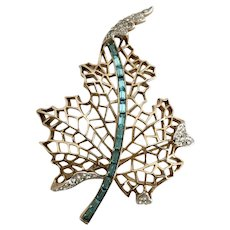 Crown Trifari Retro Leaf Brooch with Aqua Baguettes.
