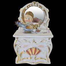German Conta Boehme Fairing Box Girl Laying down with Blue Chicken! German Porcelain