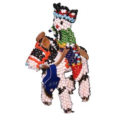 Vintage 1961 Navajo beaded rider on his horse tagged Rex