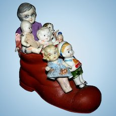 Japan bisque old lady in the shoe 7 dolls