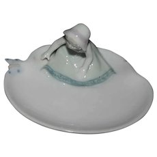 Marked glazed bisque pin dish figurine German