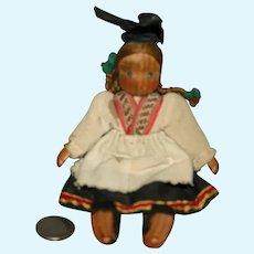 Wood jointed European regional doll