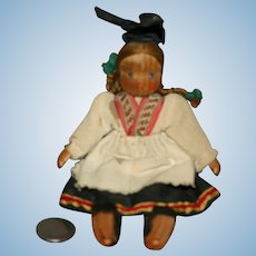 Wood jointed European regional doll