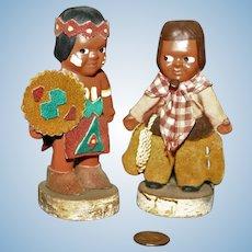 Cowboy & Indian souvenir bisque dolls