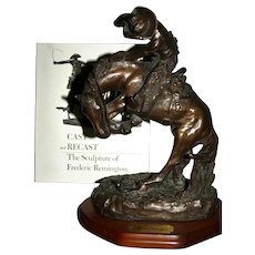 "Excellent Bronze recast Remington ""Rattlesnake"" & book"