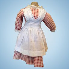 Red gingham dress with white apron antique