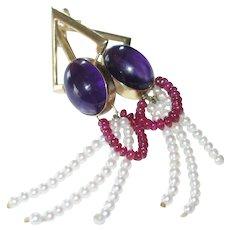 Amethyst rubies and pearls vintage 14k gold pierced earrings.