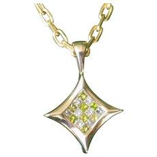 Estate Green and White diamonds pendant.