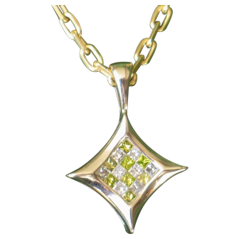 Estate Green and White diamonds pendant.