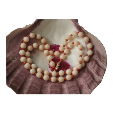 Natural coral necklace smooth bead 14k gold.