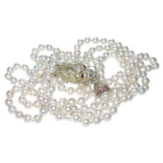 EXQUISITE!  Double Strand Pearl Necklace with Natural Rubies and Diamonds Dragon Gold Clasp.  Circa, 1920s