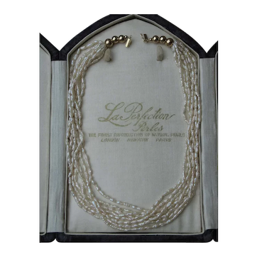 ***30%-75% off SALE *** Natural Rice Pearl 8-strand necklace 18k yellow gold.