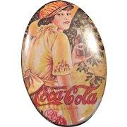 Vintage Coca Cola advertising tin
