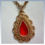 Avon Orange Glass Gold tone Pendant