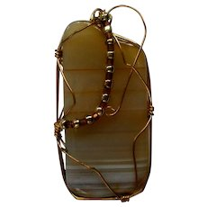 Brown Striated Agate Pendant with Gold tone Wire Wrap