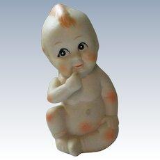 Bisque Sitting Kewpie Baby Figurine