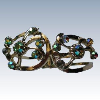 Aurora Borealis Gold tone Clamper Bracelet