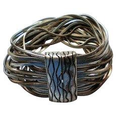 Multi Strand Silver and Copper tone Chain Bracelet